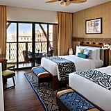 Suites offer roomy balconies and carry on the Polynesian theme with leaf-shaped ceiling fans