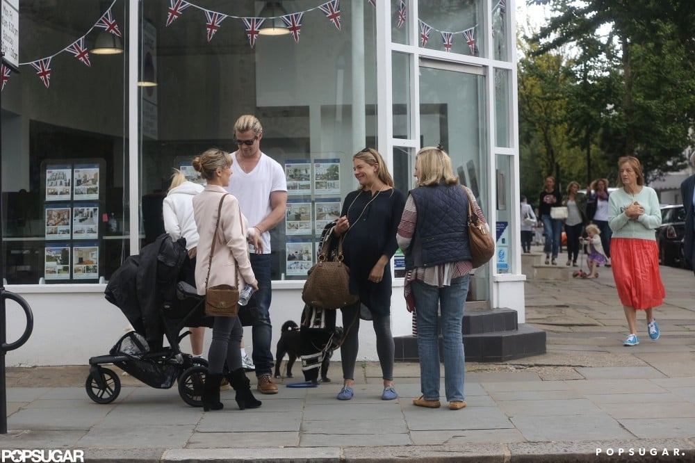 Chris Hemsworth and Elsa Pataky pushed baby India and chatted with Sienna Miller on the sidewalk in London.