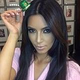 Kim Kardashian tried on a miniature green hat. Source: Instagram user kimkardashian