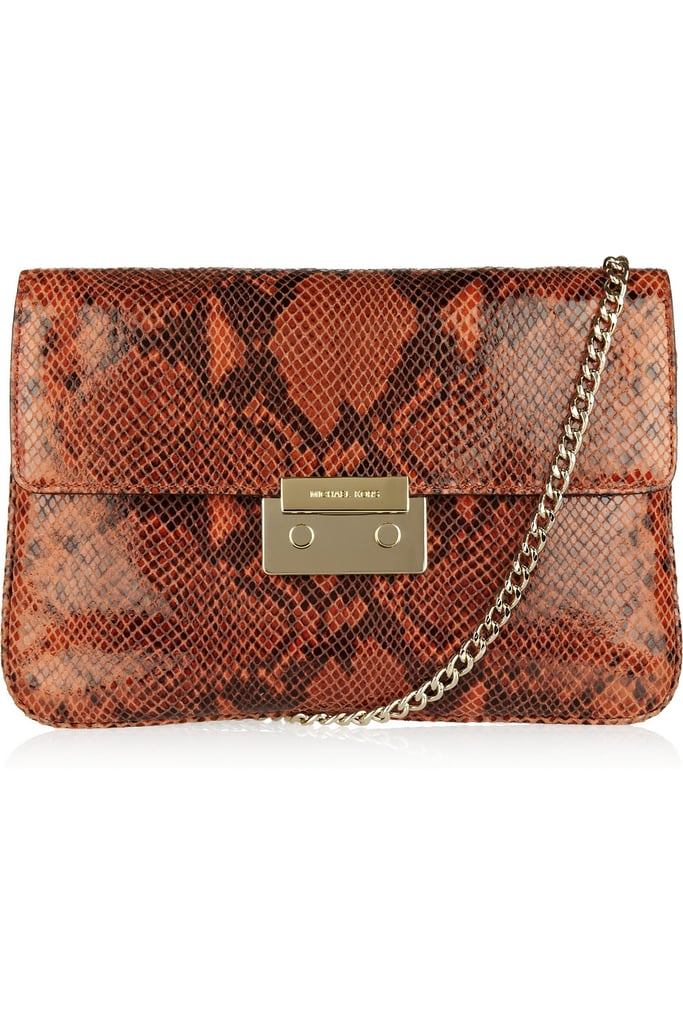 a907d44f61fe This Michael Michael Kors Sloan python-effect glossed-leather clutch ($66,  originally