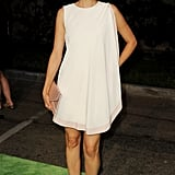 Torrey DeVitto kept it chic in a billowy LWD and cream-colored pumps.