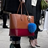 A colorblocked tote tempered a pair of wild animal-print pumps.