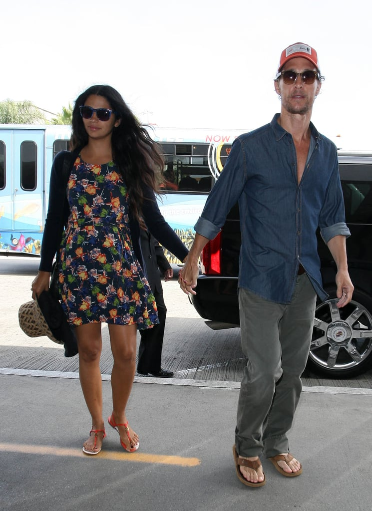 Matthew McConaughey held wife Camila Alves's hand as they got out of the car at LAX.