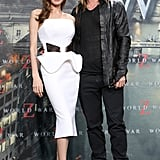 Angelina posed with Brad Pitt on the red carpet in a curve-conscious, strapless white dress with dramatic peplum trim. She completed the look with perfectly chic white pumps.