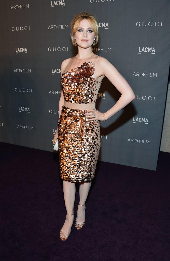 Evan Rachel Wood, who later took the stage to serenade the crowd, arrived in a gilded Gucci cocktail dress.
