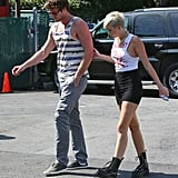 Miley Cyrus held onto Liam Hemsworth in the parking lot.