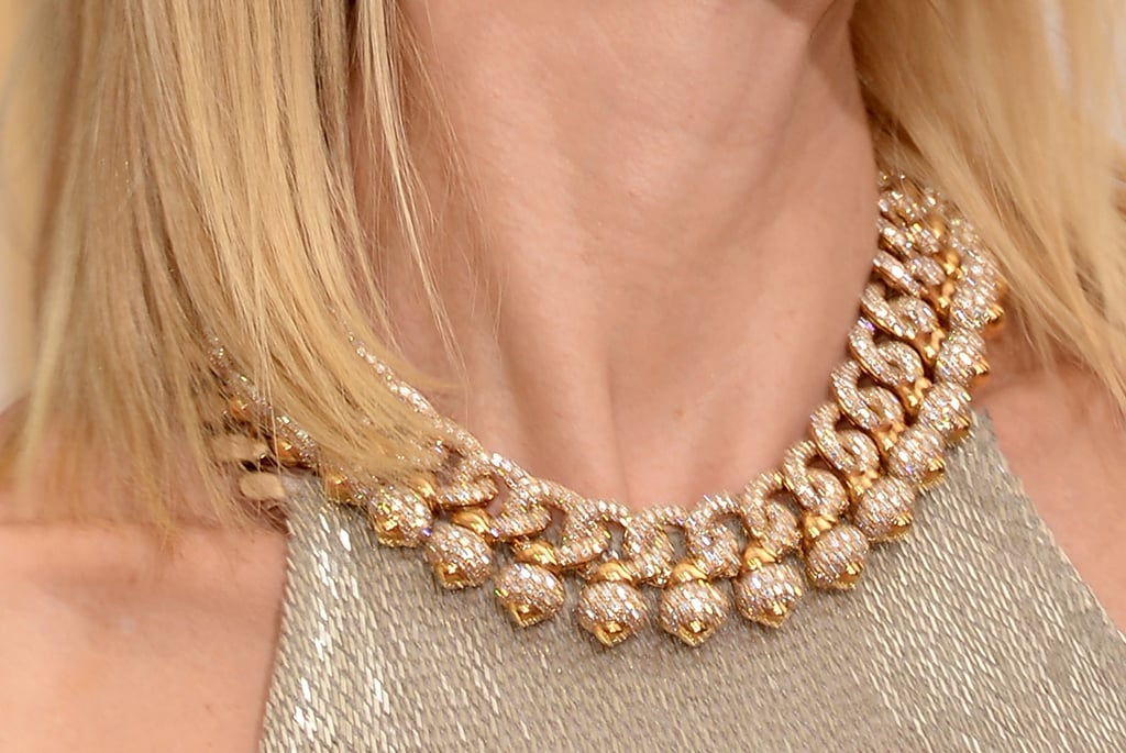 Naomi Watts added glitz with a yellow gold and diamond necklace.