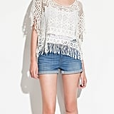 Make sure to have an extra layering piece handy —this fringe-meets-crochet top from Zara is still festive, yet cozy.  Zara Crochet Top With Fringes ($60)