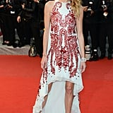 Erin Wasson donned a silky high-low light blue Antonio Berardi Spring 2012 dress that featured ruby leather petal embellishments at the Amour premiere.
