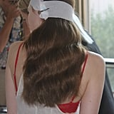 """""""This is a beautiful high society girl,"""" explained John Frieda Global Creative Consultant Luigi Murenu. """"It's very romantic, very chic —Grace Kelly 2013."""" The elegant waves were created by wrapping hair around a barrel curling iron and brushing out the curls."""