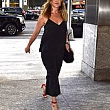She also worked the purse with breezy black coordinates and bright red sandals in New York in June 2016.