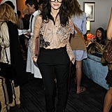 I love her pairing of high-waisted trousers and a lacy blouse. The cage heels and thick frames just add to the coolness.