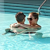 Jennifer Lopez wore a black bikini and showed PDA with Casper Smart in the pool.