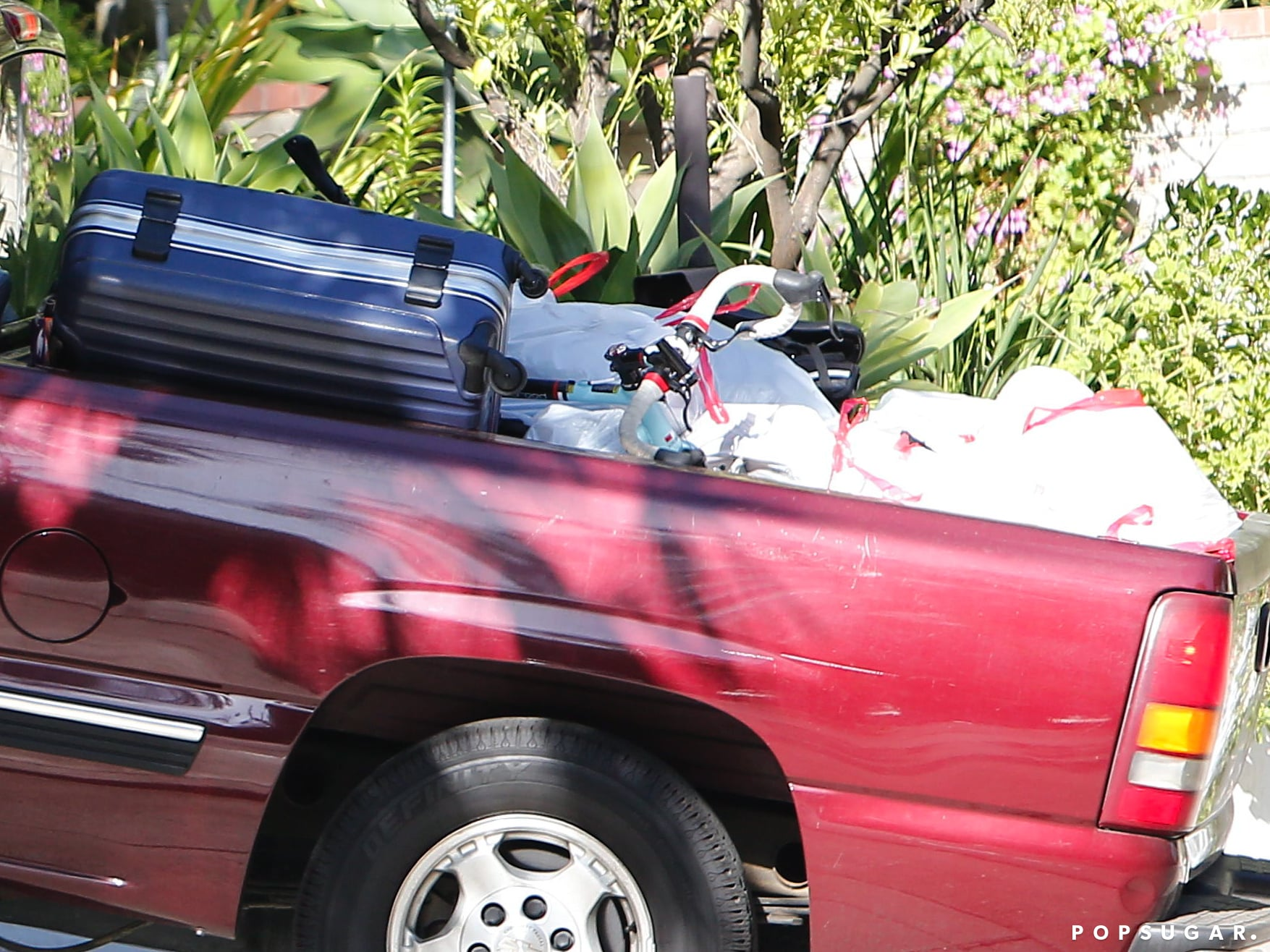 Robert Pattinson had a suitcase and several trash bags in his truck.