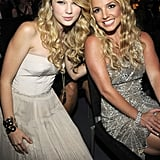 Taylor and Britney Spears struck a cute pose in the audience in 2008.