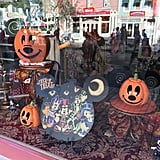 Store window displays feature Halloween gear.