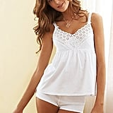 Avoid overheating with a cami set whose eyelet details make it as pretty as it is practical.   Victoria's Secret Cami and Boyshort Set ($22, originally $28)