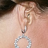 The Duchess wore crystal hoop earrings by Kiki McDonough.