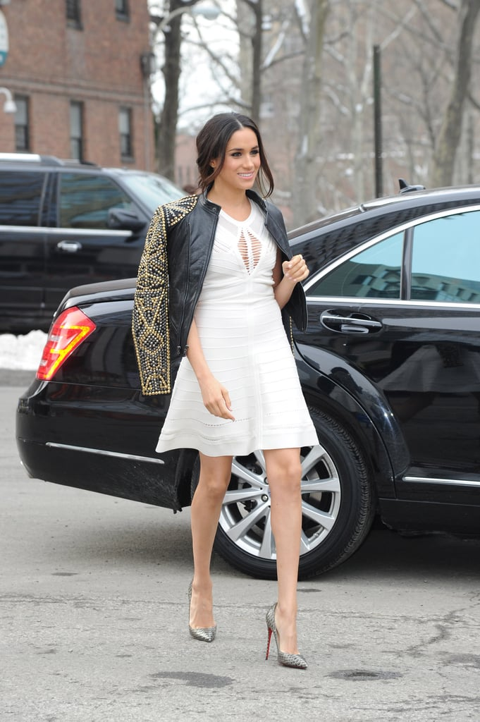 Meghan contrasted a crisp, white fit-and-flare with a studded leather jacket and Christian Louboutin heels while out in New York City in February 2014.