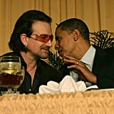 Whispering to Bono at the National Prayer Breakfast in 2006