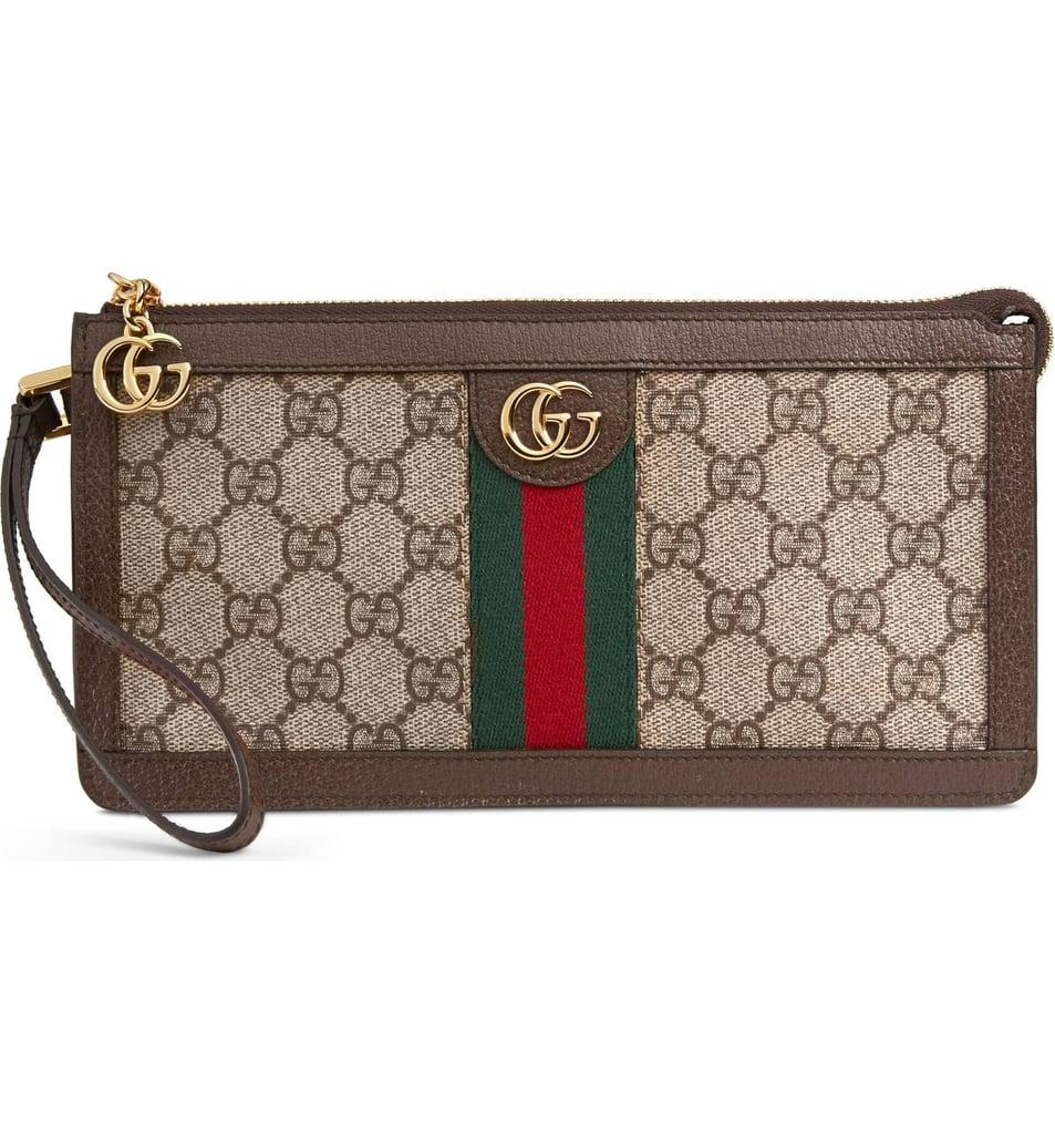 d72a36a72 Gucci GG Supreme Canvas Travel Wristlet | Angelina Jolie's Louis ...