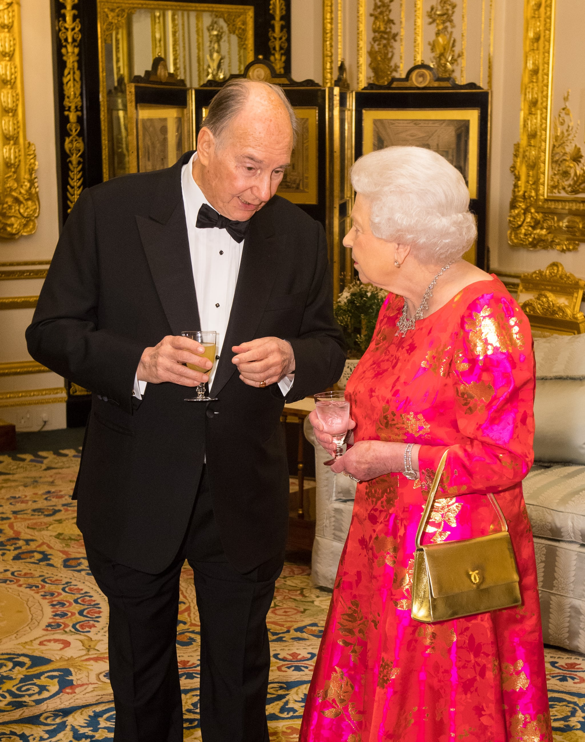 WINDSOR, ENGLAND - MARCH 8: Queen Elizabeth II and Prince Karim Aga Khan IV, prior to dinner at Windsor Castle on March 8, 2018 in Windsor, England. Queen Elizabeth II is hosting  private dinner in honour of the diamond jubilee of his leadership as Imam of the Shia Ismaili Muslim Community. (Photo by Dominic Lipinski-WPA Pool/Getty Images)