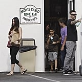 Megan Fox carried a brown bag out of the deli with Brian Austin Green and Kassius Green.