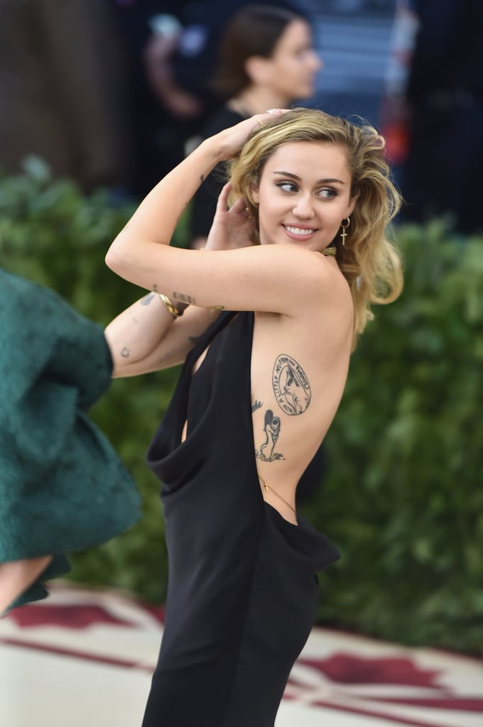 Show your faith or play up a theme with extra adornments. Miley Cyrus accessorised her backless Stella McCartney gown with Sydney Evan cross earrings at the Heavenly Bodies: Fashion & The Catholic Imagination Met Gala.
