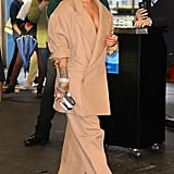 Who needs fitted pantsuits? Rihanna stuck to her love of oversize outfits with this beige blazer and trouser set in 2017.