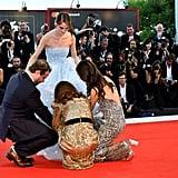 Pictured: Brady Corbet, Natalie Portman, Stacy Martin, and Raffey Cassidy