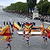 Parisian firemen perform with flags and acrobatics during the Champs-Elysees parade for Bastille Day.