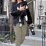 Beyoncé wore funky black-and-yellow pyramid-print pants while walking with daughter Blue Ivy Carter in NYC. She finished off her look with a black blazer, loafers, a wide-brim hat, circle sunglasses, and oversized hoop earrings.