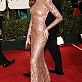 Anne Hathaway's sequin-adorned Armani gown is a prime example of a statement-making, sandy hue.