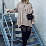 An Oversize Sweater Dress With Tights and Thigh-High Boots