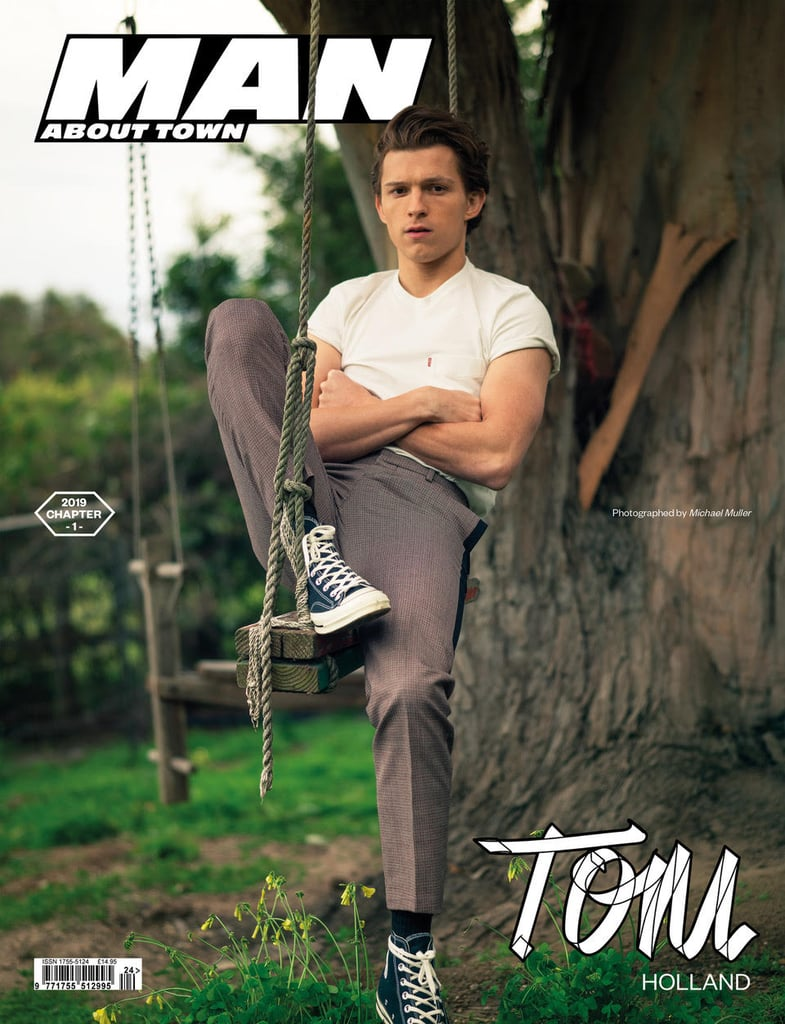 """Tom Holland is on the cover of the latest edition of indie publication Man About Town, and it's probably the 22-year-old actor's sexiest shoot to date. Shot by Michael Muller, whom Tom refers to as a """"good friend,"""" the cover shoot sees Tom showing off a slightly moodier side of his personality than normal as he reclines on a swing, stokes a fire, poses on a cliff edge, and, um, sits on a burning chair in the ocean. In the accompanying interview, the Spider-Man: Far From Home star discusses the upcoming movie (which hits theatres in July, after Avengers: Endgame answers a few lingering questions later this month). Discussing fan reactions to his character so far, Tom explained, """"One of the cool things about these movies is that we can take the audience's feedback, and put that into the third film. That's what makes the audiences as much a creative partner in these films as we are. We make them for them, and we're just lucky in the sense that we get to listen to them after every film we make, and then adapt the next one to tailor it to them.""""  Tom also touched on why he felt so comfortable playing Peter Parker/Spider-Man from day one. """"I've been playing Spider-Man in my bedroom since I was a kid. I grew up watching the films and I watched all the cartoons. I was kind of obsessed with him. When I walked on set for my first day it was my first day on the MCU (Marvel Cinematic Universe) but it was my thousandth time playing Spiderman so I felt like I had it in the bag."""" The full interview and shoot can be found in Man About Town Chapter 1, 2019."""