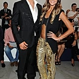 Sharni wore a cropped top and gold sequinned pants to Moncler Gamme Bleu on June 24.
