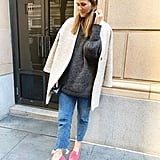 A Headband, a Dark Sweater, a White Coat, Jeans, and Colorful Flats