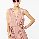 We'd rock this pretty blush-hued romper with flat nude gladiator sandals and a white blazer.  Nasty Gal Chiffon Wrap Romper ($48)