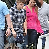 Justin Bieber walked Selena Gomez to a helicopter pad in Brazil.