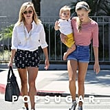 Big sis Ava Phillippe provided a helping hand, or hip, to mama Reese Witherspoon as they walked around LA with little Tennessee.