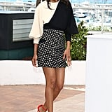Zoe Saldana added interest to her black-and-white Emanuel Ungaro look with a pair of bright ankle-strap pumps at the Blood Ties photocall.