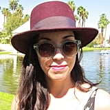 Clear sunglasses are spot on for Spring, and kudos to this lady for keeping her lips and hat in the same color family.