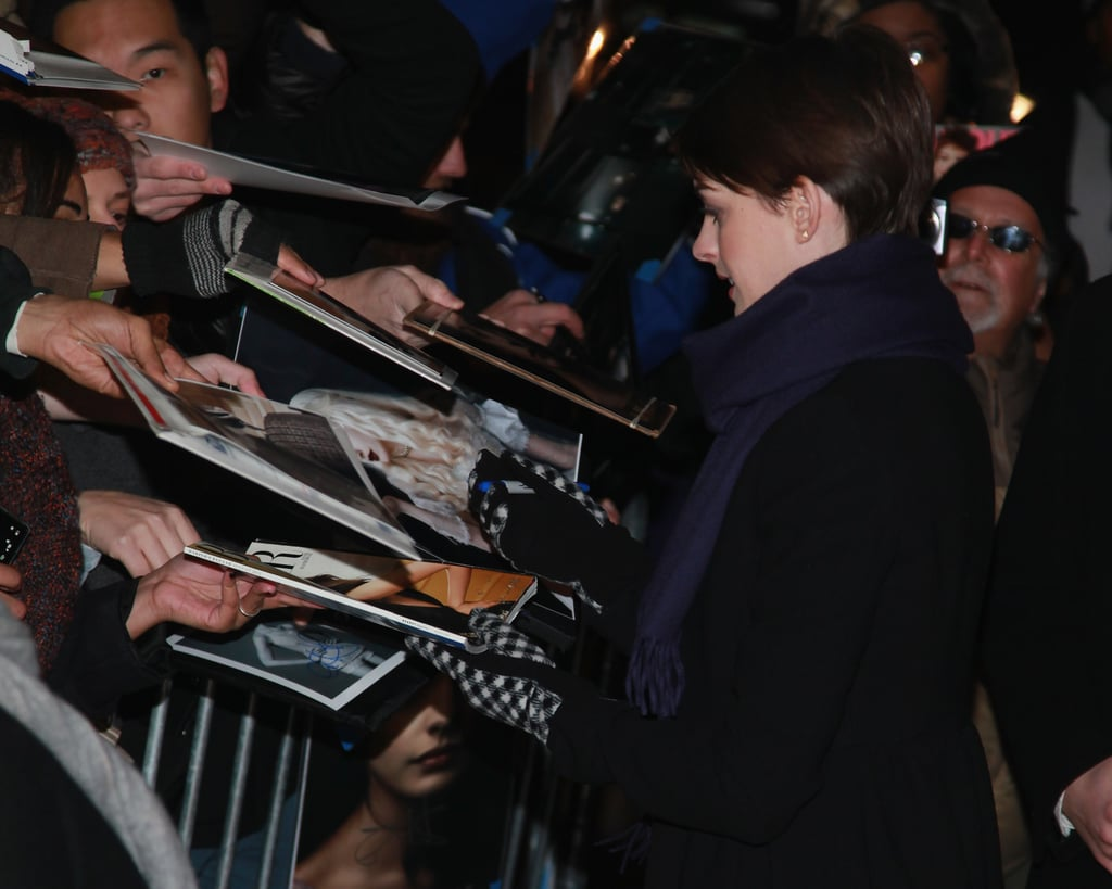 Anne Hathaway signed autographs for fans.