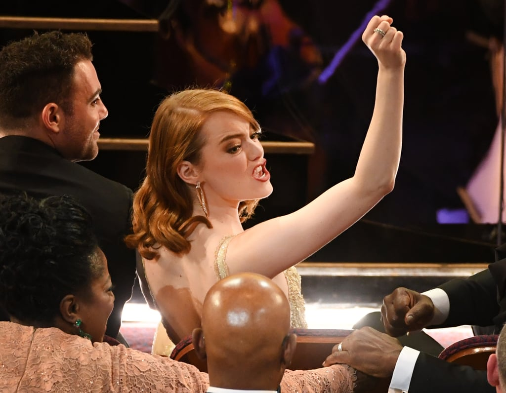 Emma Stone either busted out a dance move or really wanted someone to pass her a snack.