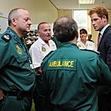 Prince Harry listens to stories about the riots.