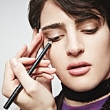 """Look at that gold glisten! """"After using Neanderthal, apply two coats of El Dorado liner,"""" suggested Rabanal. """"The brown base gives something for the gold to project off of."""" Harry wears it here on his lower lash line, adding a metallic glint and a bit of mystique to his look."""
