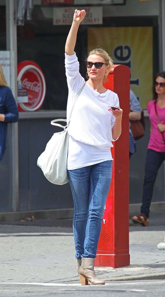 Cameron Diaz threw up her arm to hail a taxi yesterday in NYC. She's been in the Big Apple since last week. Cameron visited the Dream Downtown hotel Thursday to shop and check out a charity gala. Cameron's on the East Coast after spending time in California, where she was among the celebrity guests at Drew Barrymore's June 2 wedding. Cameron, who grew close to the bride when they were making Charlie's Angels over 10 years ago, even went along to Drew's wedding gown fitting just days before the ceremony.  LA was the latest stop for Cameron. May saw Cameron traveling the world to promote What to Expect When You're Expecting, with stops across the US and in Europe. Cameron will start racking up the frequent flier miles again later this year since she has another film on the way. Her Gambit with Colin Firth hits theaters in mid October. She'll be busy, though, with multiple projects in the works. She's got two films in preproduction, Agent: Century 21 and Ridley Scott's The Counselor. In addition, Cameron Diaz is writing a book, according to reports, about how to live healthily.