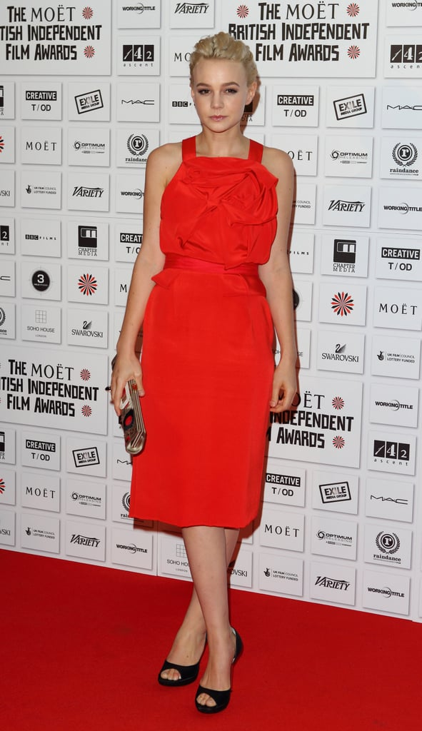 Carey earned the title of sexy sophisticate in a red Prabal Gurung sheath, complete with ruffled bodice-detail, classic black peep-toes, and a tribal Roger Vivier clutch at the British Independent Film Awards in London.