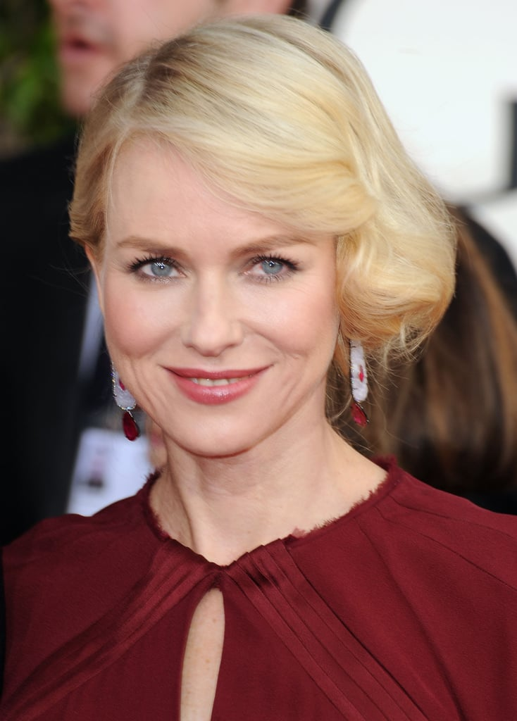 A close up of Naomi Watts on the red carpet.