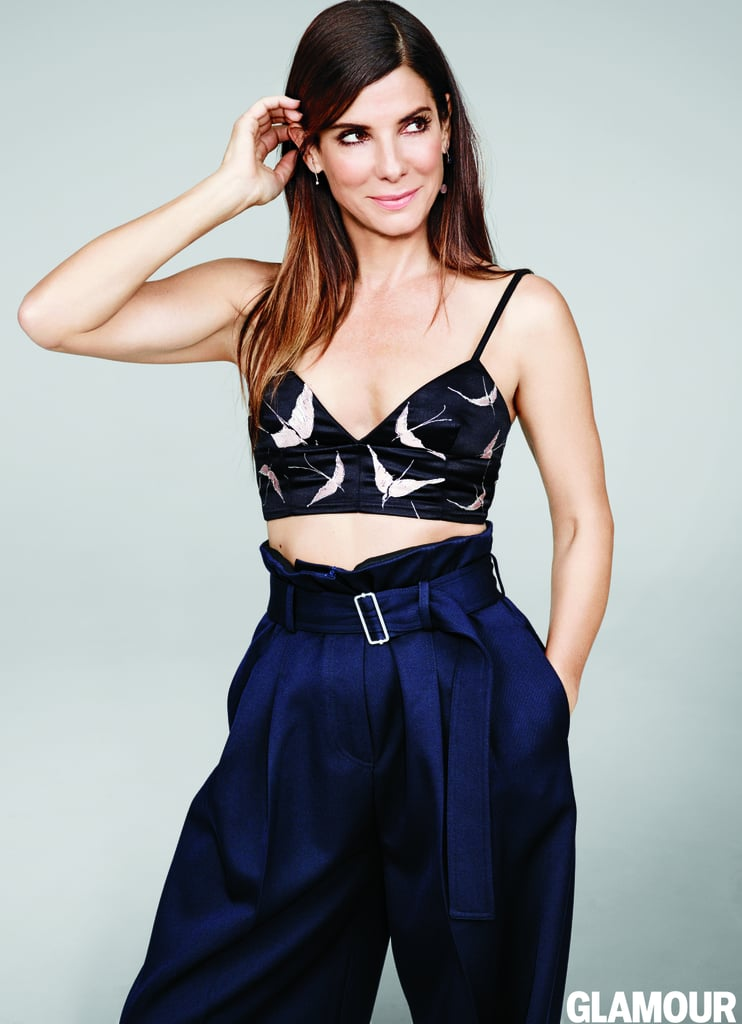 """Sandra Bullock stuns on the cover of Glamour's November issue, and in her interview with the magazine, she touches on everything from her career to motherhood to her role in her new movie, Our Brand Is Crisis. The 51-year-old star explained how she got the career she wanted, and although it's hard to believe, she insisted that because she """"wasn't classically beautiful,"""" she """"wasn't a leading lady"""" early on. Keep reading to check out more of Sandra's candid quotes, then relive all the times she lit up a room."""